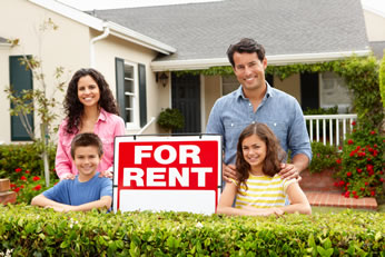 Happy Family in front of House for Sale